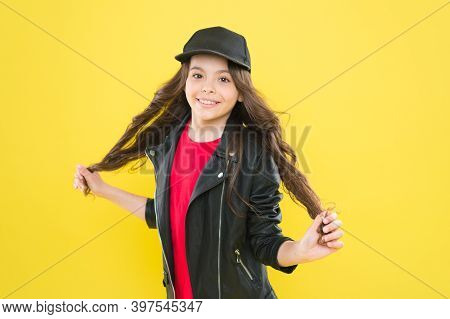 When My Hair Is Long I Go To Hairdresser. Happy Kid Hold Long Hair Yellow Background. Hairdressing S