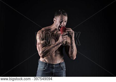 Eating Heart Healthy Diet. Bodybuilder Pretend Eating Red Heart. Cardiac Diet. Bodybuilding Diet. Di