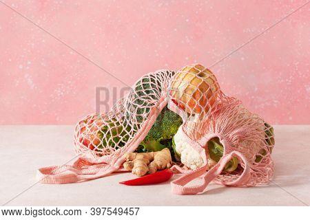 fruits vegetables in reusable mesh cotton bag, plastic free zero waste concept