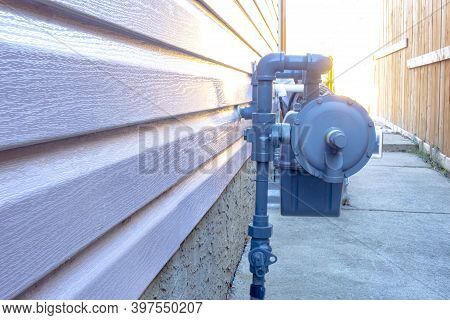 Side View Of A Residential Urban Natural Gas Meter, Measuring Gas Consumption, Outside House Gas Met