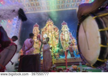 Blurred Image Of Traditional Dhaaks, Being Played While Hindu Bengali Purohit Worships Goddess Durga