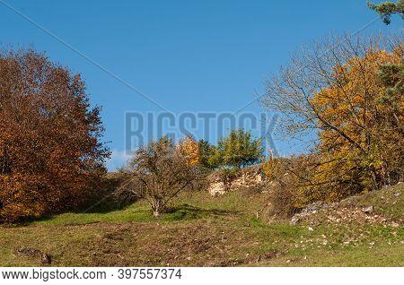 Autumn In A Hilly Landscape With Limestone Rocks In Swabian Alb In Germany