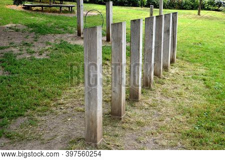 Wooden Natural Oak Beams Embedded In The Ground. Used For Circling And Zigzagging Between Obstacles.