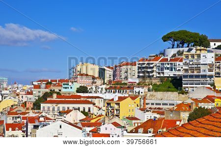 Lisbon panorama Portugal. Buildings roofs churches at blue sky poster