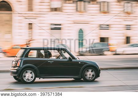Rome, Italy - October 21, 2018: Mini One Hatch Mini Cooper Car Driving On City Street