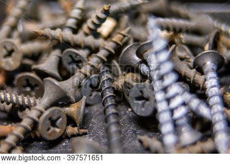 Macro Photo Of Screws. Set Of Screws. Construction Abstraction. Industrial Background. Screws Macro