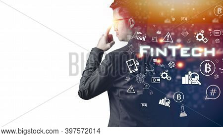 The Double Exposure Image Of The Businessman Standing Overlay With Fintech Code And Business Icon Wi