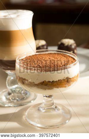 Tiramisu Italian Dessert Served With Coffee On A Table