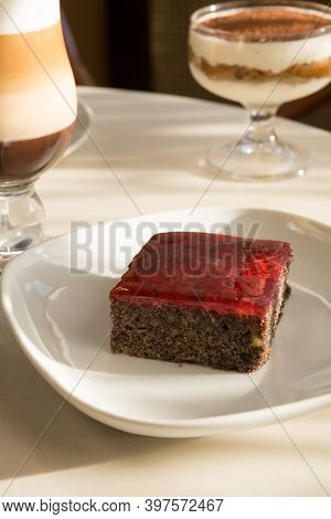 Piece Of Cake Served With Coffee In Cafe