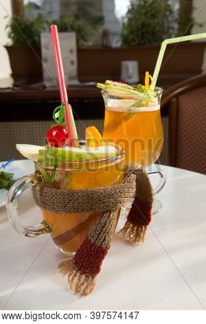 Decorated Warm Winter Cocktails Served On A Table