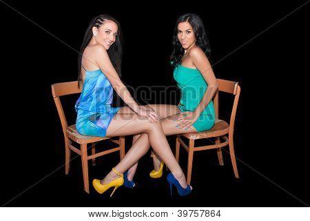 Happy Women Fiends Sitting On Chair