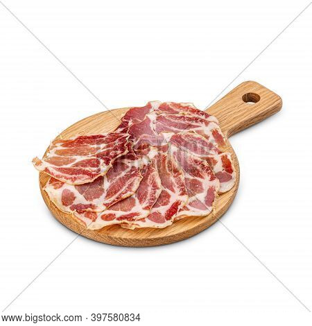 Italian Sliced Cured Coppa On Wooden Cutting Board, White Background