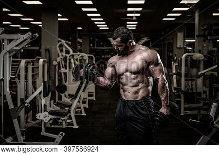 Success Concept Of Strong Young Male Bearded Athlete Lifting Heavy Weight Dumbbells In Fitness Sport