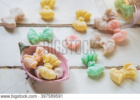 High Angle Views Allure Thai Candy In A Mini Bowl On A White Wooden Table, Allure Is Traditional Tha
