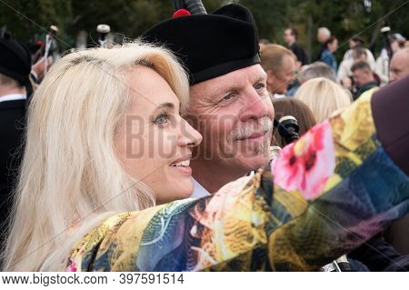 Moscow,museon Park,september 4, 2016: A Pretty Smiling Young Blonde Takes A Selfie With A Musician F