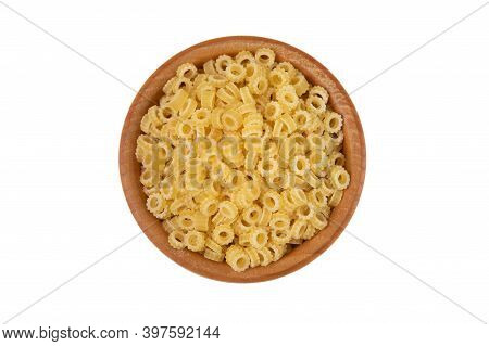 Pasta In Wooden Bowl Isolated On White