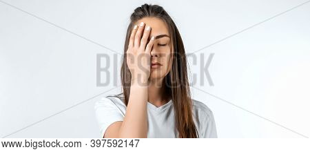 Young Woman With Long Chestnut Hair, Covers Face, Closes Eyes, Feels Fatigue, Needs Good Rest, Has S