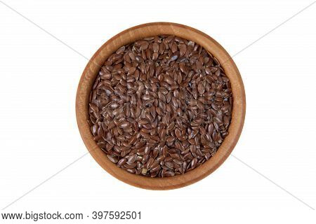 Linseed In Wooden Bowl Isolated On White Background