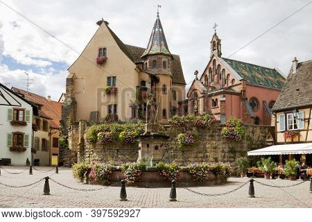 Eguisheim, France - September 10, 2010: The Castle, Church And Fountain Named Saint Leon On The Cent