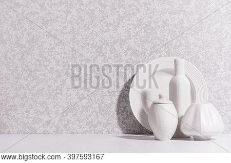Scandinavian Minimalist Interior With Ceramic Crockery - Bottle, Dish, Vases In Sun Beam With Shadow