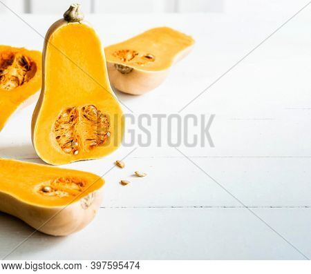 Butternut squash with seeds on white table