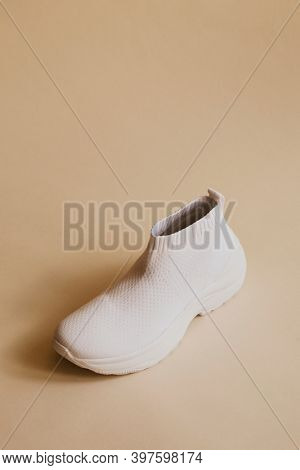 White knitted high top sneakers aerial view