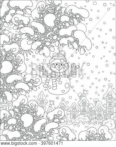 Cute Toy Snowman With A Striped Scarf And A Warm Hat Hanging On A Snow-covered Prickly Fir Branch Of