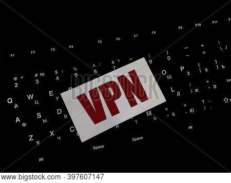 The Word Vpn On White Paper In Red Letters On A Black Keyboard On A Black Background. Virtual Privat