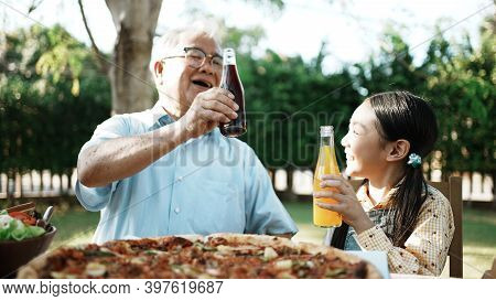 Happy Asian Grandchild Drinking Juice Grandpa. Multi Generation Family Enjoying Meal. They Having Ou