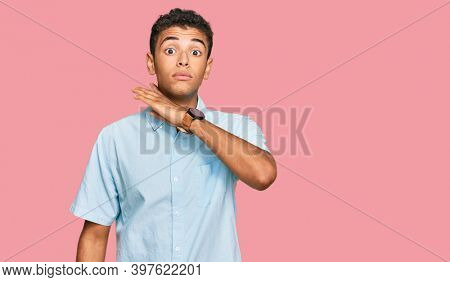 Young handsome african american man wearing casual clothes cutting throat with hand as knife, threaten aggression with furious violence
