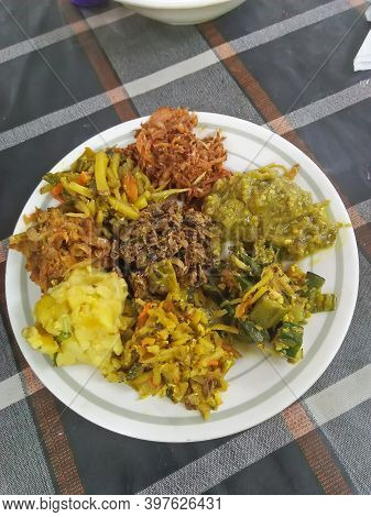 Eight Type Of Indian Mashed Food,potatoes, Dried Fish, Lady's Finger, Aubergine, Tomatoes All Mashed