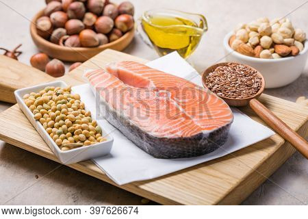 Omega 3 Food Sources And Omega 6 On Concrete Background, Top View Omega-3, Copy Space. Foods High In