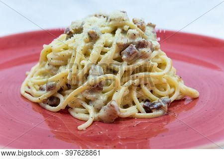Authentic Italian Food Shows Pile Of Cheesy Carbonara Spaghetti Pasta And Ready To Eat.