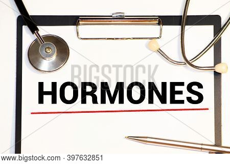 Hormone Growth Hormone Written On Notebook. Test Tubes And Hormones List
