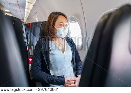 Woman Wearing Face Mask Is Traveling On The Airport , New Lifestyle Travel After Covid-19. Social Di