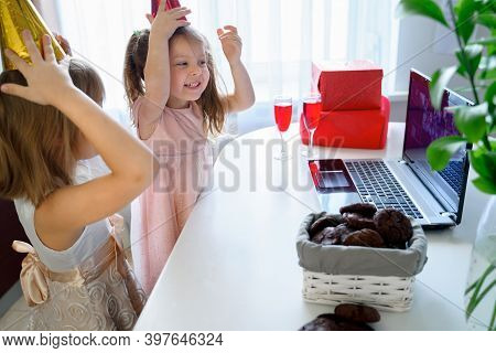 Kids Virtual Birthday Party.girls In Dresses And Caps Celebrate Holiday With Friends On Isolation.on