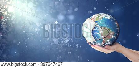 Hands Holding Earth Global In Abstract Christmas Lights Background . Elements Of This Image Furnishe