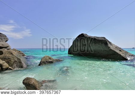 The Cliffs Rise Above The Clear, Transparent Aquamarine Water Of The Andaman Sea. There Are Light Wh