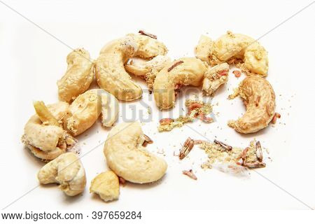 A Picture Of Cashew Nuts Infested With Caterpillars And Butterflies Of The Meal Moth. Isolated On A