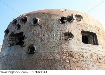 The Bullet Holes In The Armor Of The Bunker Turret From Second World War.