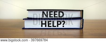 Need Help Symbol. Books With Words 'need Help' On Beautiful Wooden Table, White Background. Business