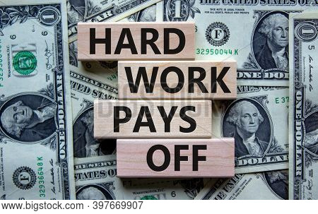 Hard Work Pays Off Symbol. Stack Of Wooden Blocks With Words 'hard Work Pay Off'. Beautiful Backgrou