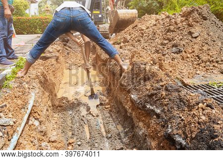 Plumber Work Dig Repair Water Line Connect Pvc Pipe Main Plumbing On Road And Backhoe