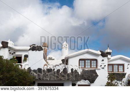 Tías, Las Palmas, Spain - January 21, 2019: Low Angle View Of Houses Against Sky.