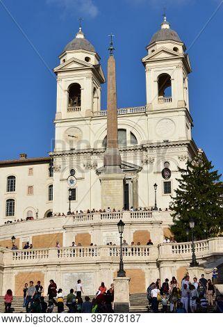 Rome, Italy. Oct 13, 2019. Church Of The Santissima Trinita Dei Monti With The Obelisco Sallustiano