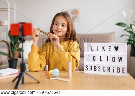 Portrait Of Young Girl Vlogger Recording Video Live Broadcast On Smartphone Camera At Home. Kid Blog