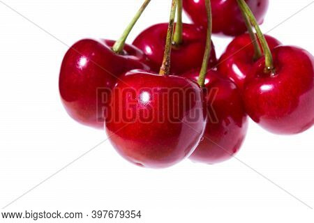 Seven Organic Sweet Cherries Isolated On A White Background. Clo