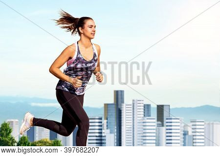 Close Up Portrait Of Young Woman Jogging Against City Skyline. Side View Of Girl In Sportswear Runni