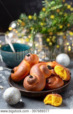 Traditional Swedish Buns In Christmas Setting. Saffron Bun, In Swedish Lussebulle Or Lussekatt. Wint