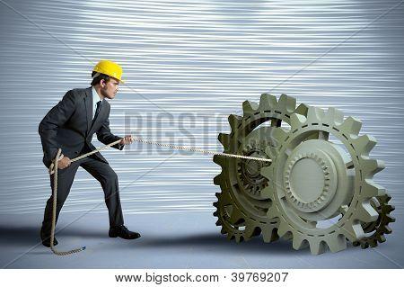 Businessman Turning A Gear System